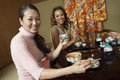 Women Having Japanese Saki In Restaurant Royalty Free Stock Photo