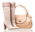 Women high-heeled boots and leather bag Royalty Free Stock Photo