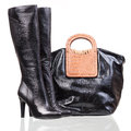 Women high-heeled boots and leather bag over whit Royalty Free Stock Images