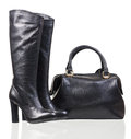 Women high-heeled boots and leather bag on white Royalty Free Stock Images