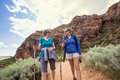 Women hiking together in a beautiful red rock canyon Royalty Free Stock Photo