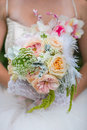 Women holding flowers and bouquet Royalty Free Stock Photo