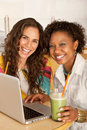 Women on a Laptop Royalty Free Stock Photos