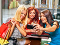 Women at laptop in a cafe gossip with Royalty Free Stock Photography