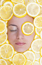 Women with lemons on face Royalty Free Stock Images