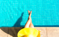 Women lifestyle relaxing near luxury swimming pool sunbath, summer day at the beach resort in the hotel Royalty Free Stock Photo