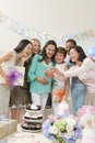 Women Looking At Camera At A Baby Shower Royalty Free Stock Image