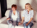 Women looking film comedy mother with adult daughter watching television Royalty Free Stock Photography