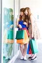 Women looking in shop window Royalty Free Stock Photo