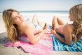 Women lying on the beach with beer bottle Royalty Free Stock Photo
