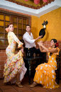 Women and man in traditional flamenco dresses dance during the feria de abril on april spain men Royalty Free Stock Image