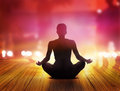 Women are meditating at night and purple rays of light  in the city Royalty Free Stock Photo
