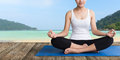 Women meditation yoga on wood balcony beach Royalty Free Stock Photo