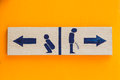 Women and men toilet sign blue on white board Royalty Free Stock Image