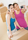Women moving into new home Royalty Free Stock Photography