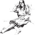 The women in national clothes sits thoughtful pose drawing on white paper Royalty Free Stock Photos