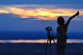 Women nature photographer with digital camera on the mountain Stock Image