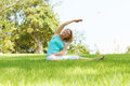 Women outside practising yoga in the meadow Stock Photo