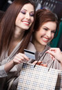 Women pay for purchases with credit card Stock Images