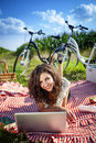 Women picnic and computer on grass in summer Royalty Free Stock Photo