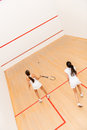Women playing squash at the court a match of Royalty Free Stock Photos