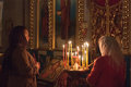 Women pray at easter gomel may in front of the icon in belarusian orthodox church on may in gomel belarus Royalty Free Stock Images
