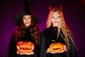 Women with pumpkins portrait of two happy females looking at camera smiles Royalty Free Stock Photos
