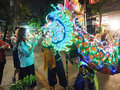 Women put a money in dragon mouth in vegetarian festival