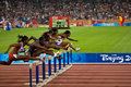 Women racing 110M hurdles Stock Photos