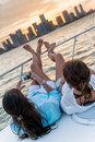 Women relaxing on a yacht and taking picture Royalty Free Stock Image