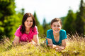 Women resting outdoor mother with daughter after exercising Stock Photos