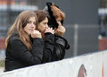 Women rugby fans pictured in action during the amlin challenge cup game between bucharest wolves and newcastle falcons Royalty Free Stock Photography