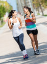 Women running outdoors athletic looking very happy Royalty Free Stock Image