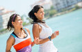 Women running outdoors happy by the beach fitness concepts Royalty Free Stock Image