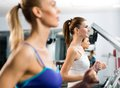 Women running on a treadmill Stock Images