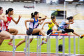 Women's 100 Meters Hurdles Action (Blurred) Royalty Free Stock Photo
