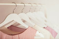 Women`s clothing in pink tones on a white hanger. Royalty Free Stock Photo