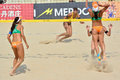A women s fivb world tour game in progress beach volleyball is which has achieved worldwide popularity photo taken october Royalty Free Stock Photography