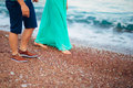 Women`s and men`s feet in the sand Royalty Free Stock Photo