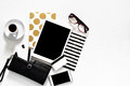 Women`s office desk on white background touch pad tablet with gold stylish books black wallet credit cards, top view Royalty Free Stock Photo
