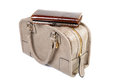 Women s purse is on top of the bag isolated Stock Photos