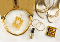 Women's set of fashion accessories in golden color