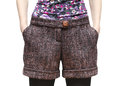 Women s shorts from wool tweed with hands in pockets closeup isolated Royalty Free Stock Photography
