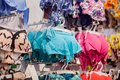 Women`s swimsuits for sale at a seaside shop. Advertise, Sale, Fashion concept Royalty Free Stock Photo
