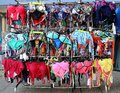 Women`s swimwear on a hanger outside a shop near the beach Royalty Free Stock Photo