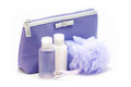 Women s violet set of body milk with cosmetic bag small Royalty Free Stock Image