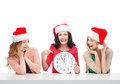 Women in santa helper hats with clock showing christmas x mas winter happiness concept three smiling Royalty Free Stock Photos