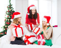Women in santa helper hats with many gift boxes christmas x mas winter happiness concept three smiling Royalty Free Stock Photos