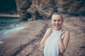 Women secret. Young beautiful shy smiling woman in bikini on beach looking at camera during beach holidays Royalty Free Stock Photo