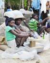Women selling grain at a market in fond baptiste haiti two sitting together surrounded by the they re the focus on woman with Stock Image